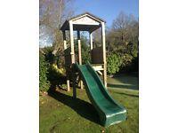 Children's wooden playhouse/ slide. Wood with tough fibreglass slide
