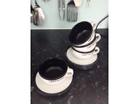Set of 4 black and white cappuccino cups and saucers