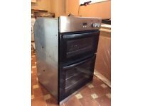 New World built in double fan assisted electric oven.