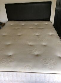 Double divan bed with mattress base has 4 drawers in base