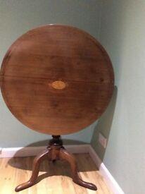 Round flip top antique table