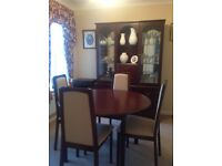 Beautiful extendable dining table, 4 upholstered chairs and matching display sideboard