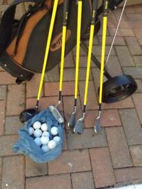 Full set of junior right handed golf clubs bag and trolly