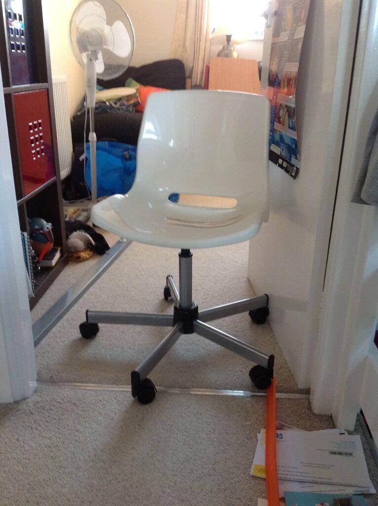 White plastic swivel chair.