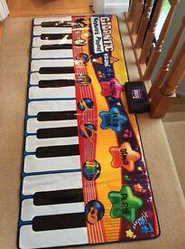 Gigantic keyboard/piano playmat