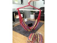 Brand new unwanted gift, an adult multi coloured rope swing, the cushions are still in plastic bags.