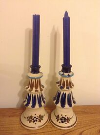 Pair of tall pottery candle holders (not identical but very similar)