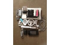 Wii U with pro controller and 5 games. Original Wii consoles with Wii Fit board and 25 games.
