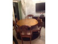 Ducal light oak extendable table and 6 fabric covered chairs in good condition.