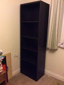 Tall IKEA very dark brown bookshelf