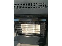 Portable Gas (butane) Heater in cabinet. Max output of 4.2 kW with gas cylinder refill agreement