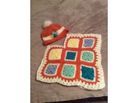 Hand crocheted children's hat and ponchos