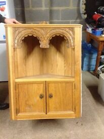 Lovely corner wall hung cupboard. Two front opening doors for storage with shelf over top.