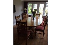 Pine Table 8ft x 4ft with 8 pine chairs, upholstered seats, good condition.