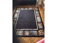 2. Very large Safari style rugs in very good condition.