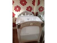 Travel cot bed with changing table lights up and plays music