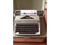 Vintage manual typewriter-Olympia with carry case