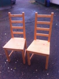 Pair of pine ladder back dining chairs