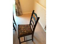 6 Dark oak ladder back chairs 2 of which are carvers with padded seats