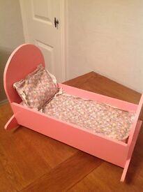Dolls pink cradle
