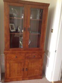 Walnut effect wooden display cabinet.