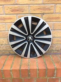 Peugeot Wheel Trims Sliver and Black used
