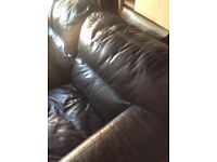Brown two seater leather sofa for sale.