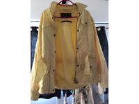 Woman's pastel yellow Barbour jacket