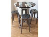 Dining table and stools