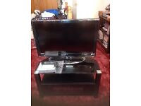 32 inch LCD TV with stand. Glass cabinet.
