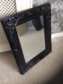 Gloss black ornate mirror