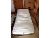 SINGLE STOWAWAY FOLDING BED. IMMACULATE CONDITION,NEVER USED. STURDY,COMFORTABLE OCCASIONAL BED.