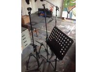 3 mic, 1 music, 2 guitar stands and a pop shield