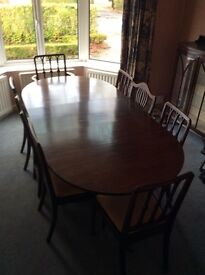 Mahogany dining table and chairs plus glass fronted cabinet