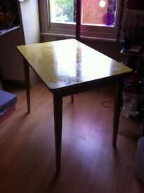 Bright, sturdy, vintage, 1960s yellow formica table with tapered detachable legs, 60cm x 90cm