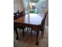 Antique Dining Table and Four Re-upholstered Chairs