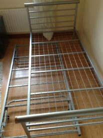 Single Bed (Metal Frame )with additional pull out bed underneath great for guests and kids bedrooms