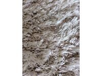 Pagazzi cream shag pile rug. Measurements 160 by 230