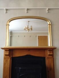 Large mirror, ideal over a fireplace. Brass effect frame.
