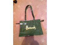 A glamorous zipped green vinyl bag, from Harrods of Knightsbridge, London.