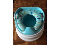 Potty with soft seat. As new condition. Seat is removable so can be used on toilet as well.