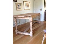 Elm refectory dining table.Bespoke made from reclaimed elm barn door.Seats eight people comfortably