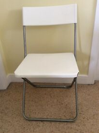 Easy foldable white seated chair