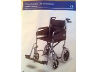 Days Escape Lite Wheelchair and cover with 15 months guarantee remaining.