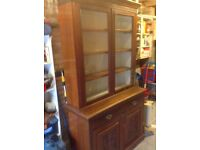 Old Fashioned Dresser with glass cupboard on top and storage underneath.