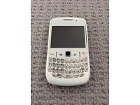 Blackberry curve 8520 pearlescent white and black.