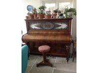 Pretty upright piano with piano stool