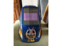 Miller Electric welding helmet with bag & 5 spare batteries only used three times like new