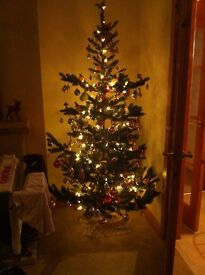 6 foot 6 inch artificial Christmas tree with stand - very realistic and used once.