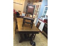 Large vintage dining table with four chairs